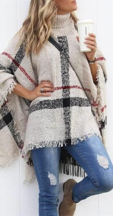 Girl wearing off-white with black and red checkered jeans and poncho