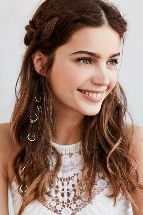 Girl with loose hair and side braid with rings; Hairstyles with hoops