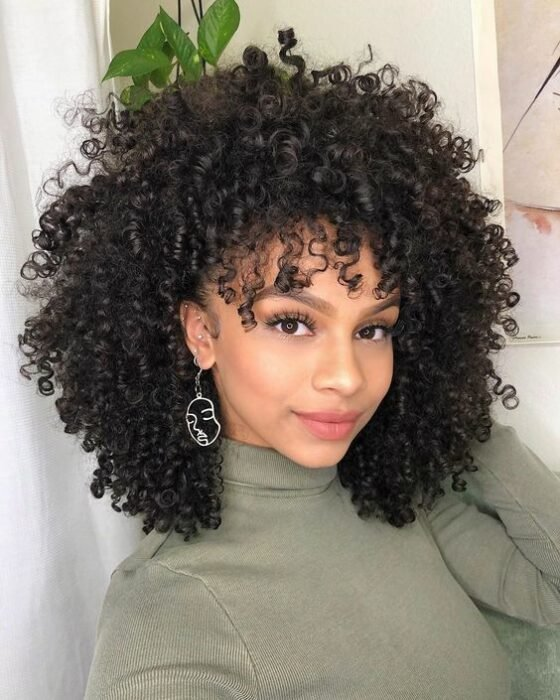 Girl with curly hair combed naturally; Hairstyles for curly hair girls