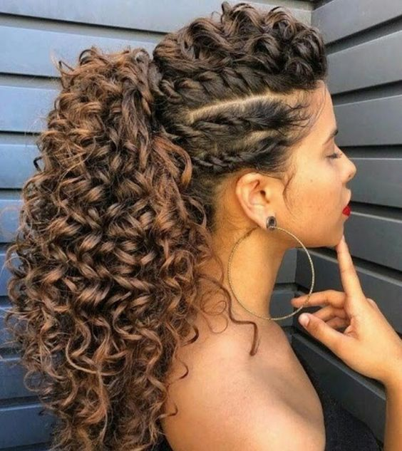Girl with curly hair combed into a high ponytail with braids; Hairstyles for curly hair girls