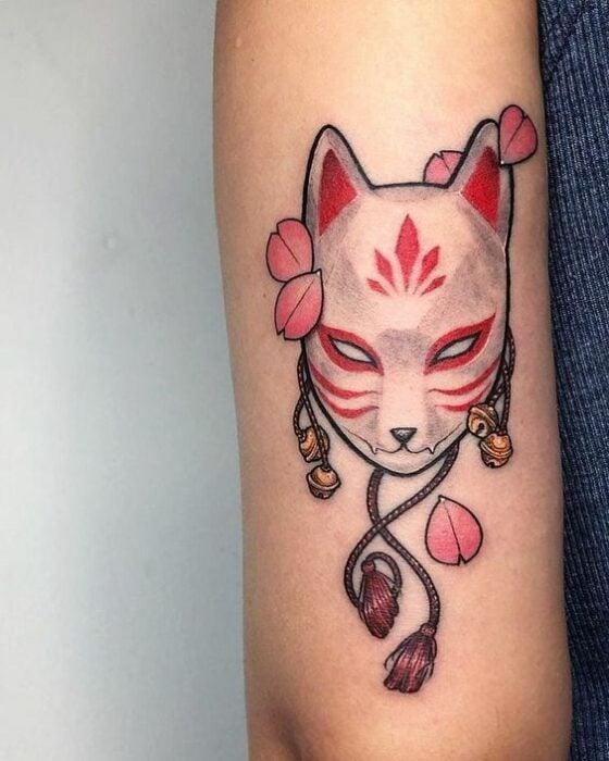 Asian white fox mask on arm