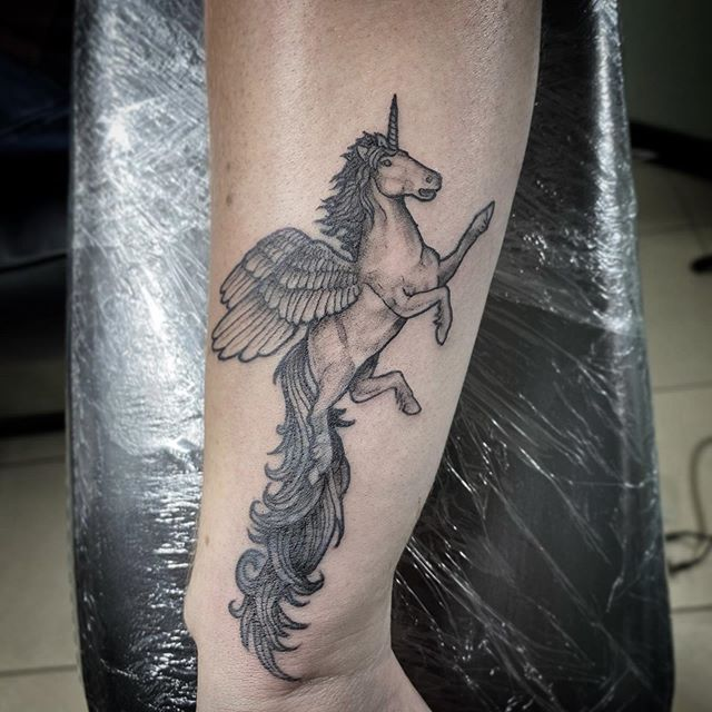 Stuck tattoo on arm