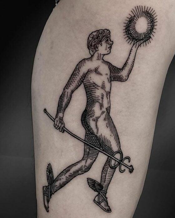 Hermes tattoo on arm