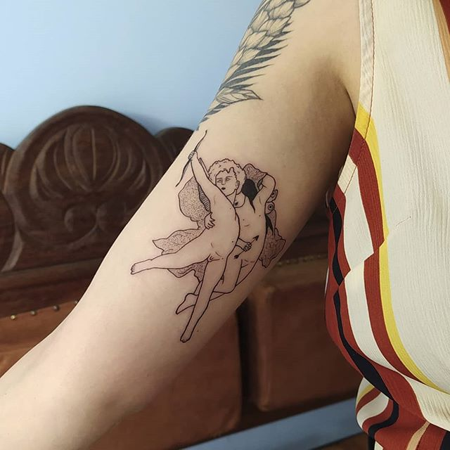 Eros and Psyche tattoo on the arm