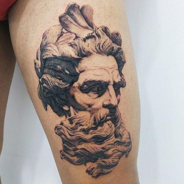 Poseidon tattoo on leg