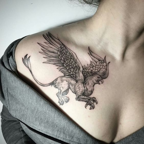 Griffin tattoo under the clavicles