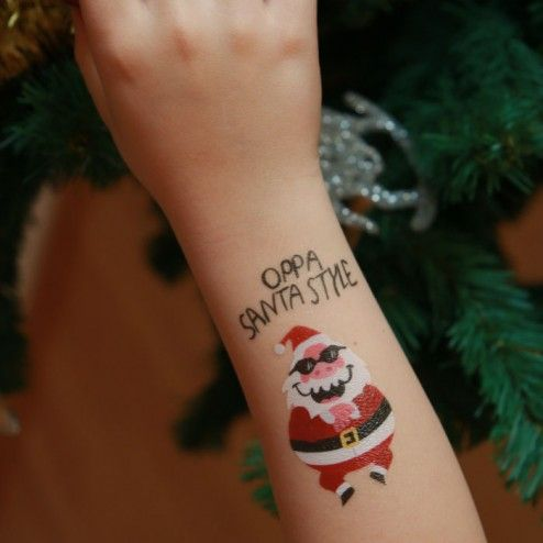 Girl with Santa Claus tattoo; Tattoos for girls who love Christmas