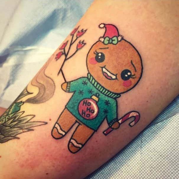 CXgirl with gingerbread cookie tattoo; Tattoos for girls who love Christmas