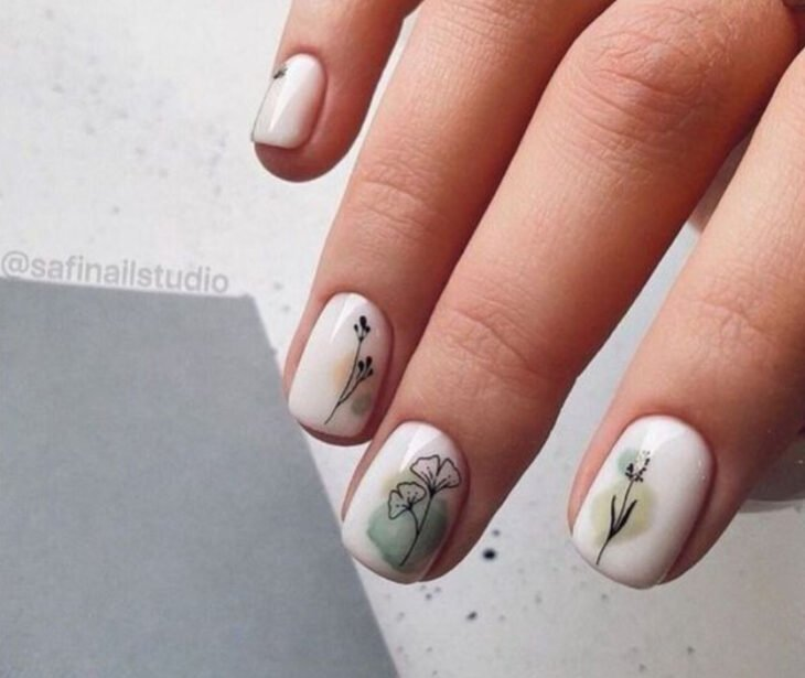 White manicure with freehand flower details