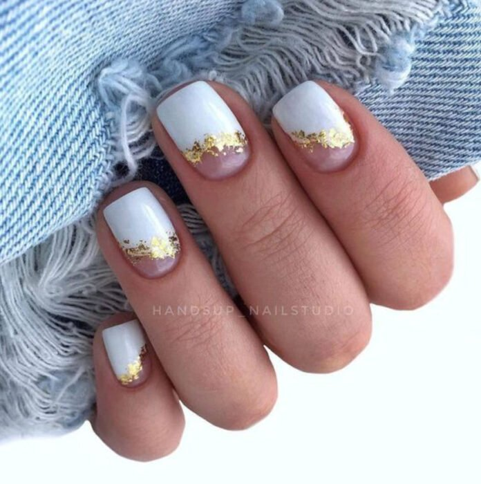 Manicure in white with gold and nude part