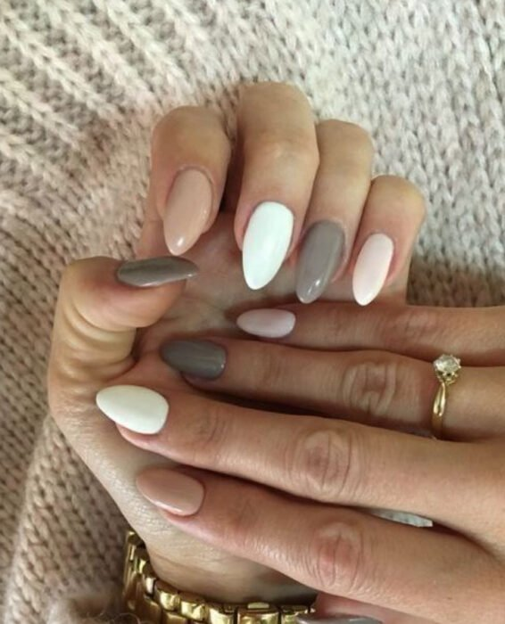 Different colored manicures, such as baby pink, white, and gray