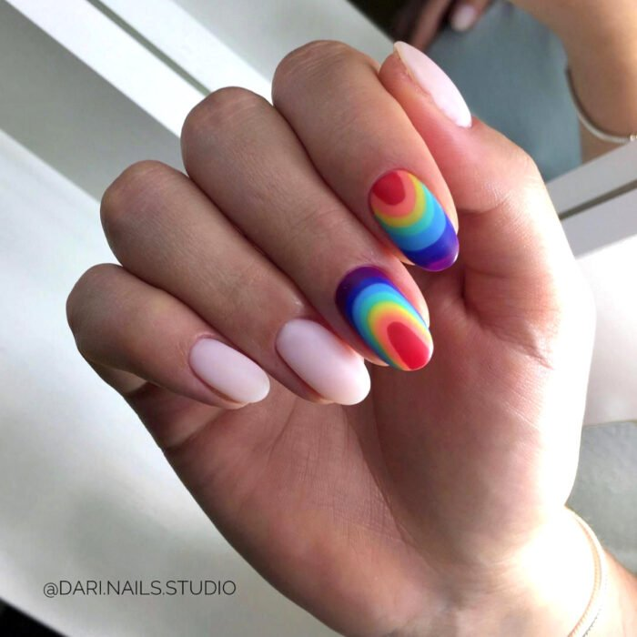 Pretty colorful manicure designs; long round nails painted with matte nail polish in rainbow colors, nude, purple, strong and light blue, green, yellow, orange and red
