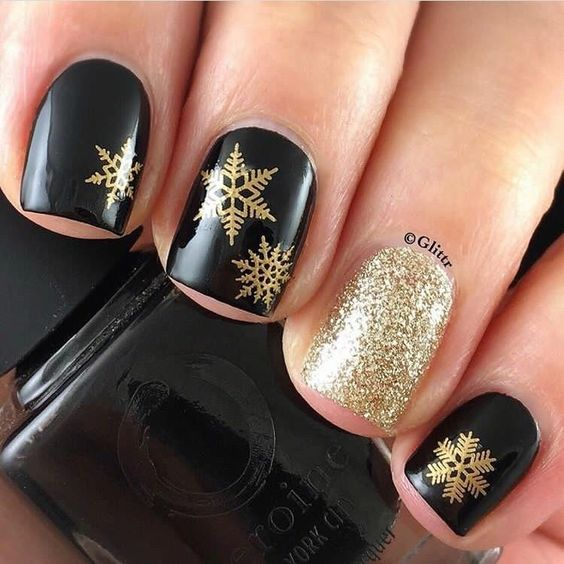 Manicure in black with gold glitter; Glitter nails for Christmas