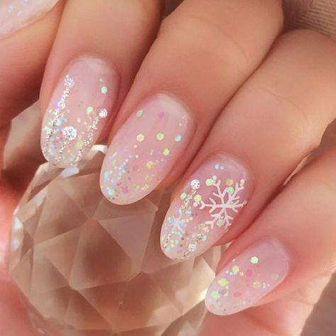 Transparent manicure with white and glitter details; Glitter nails for Christmas