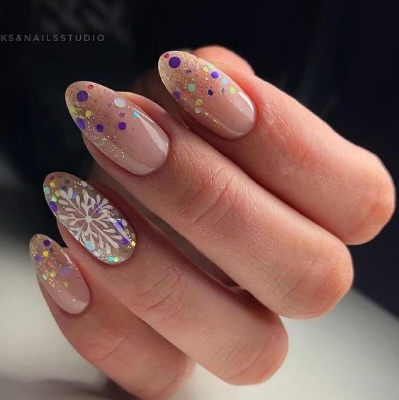 Transparent manicure with details of snowflakes; Glitter nails for Christmas