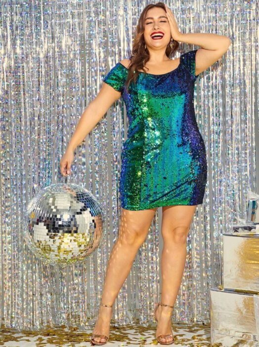 Iridescent, holographic dress with sleeves, plus size woman with brown hair, long hair, wavy hairstyle, with disco ball in hand