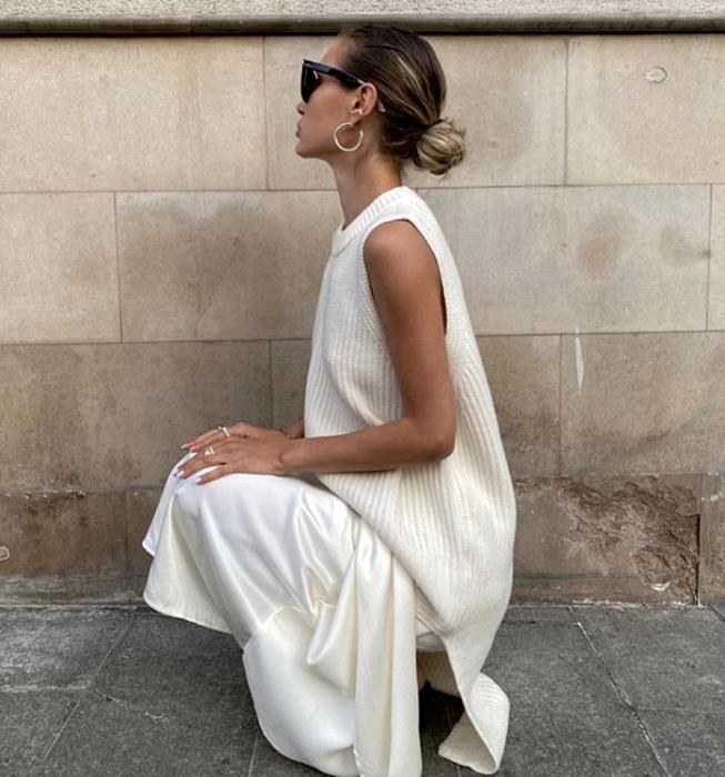 blonde girl with sunglasses, white knit sleeveless sweater, white satin skirt