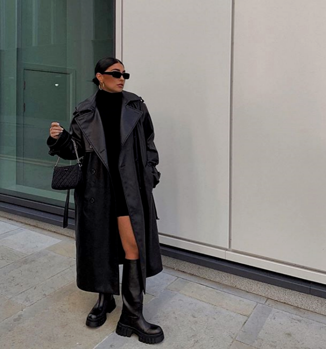dark haired girl with sunglasses, high neck black mini dress, long leather coat and long black leather thick soled boots