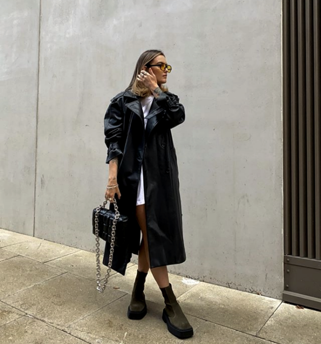 blonde girl with sunglasses, white mini dress, long leather coat, thick soled boots, black leather handbag