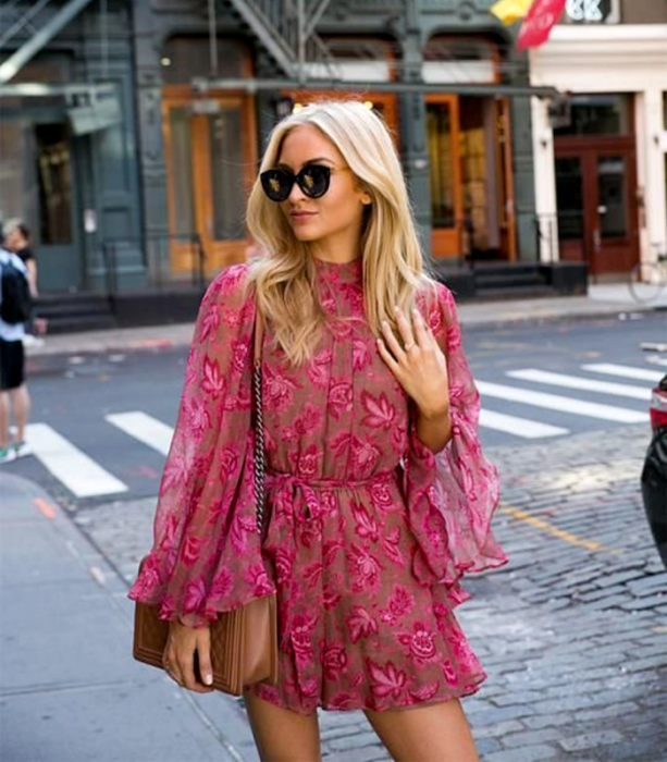blonde girl with sunglasses, pink dress with puff sleeves with flower print and waist adjustment, beige leather bag with silver chain strap