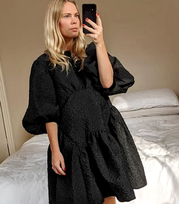 blonde girl wearing short puff sleeves black dress with skirt volume and texture