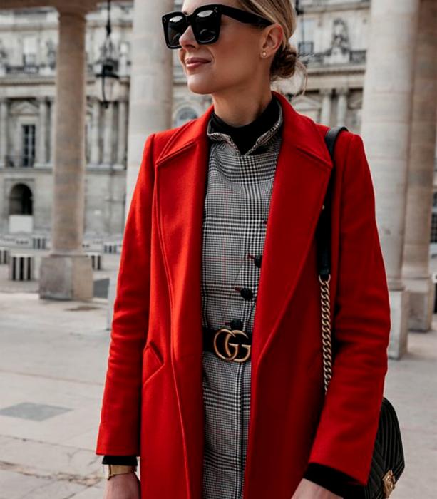 blonde girl wearing sunglasses, long red coat, gray plaid dress, black gucci belt and black handbag