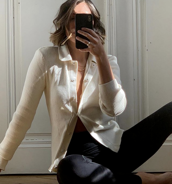short hair girl wearing white knitted cardigan, black leggings