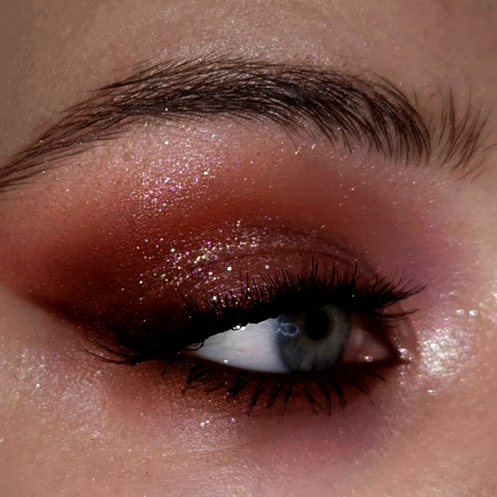 eye makeup with brown, red, cherry and pink shadows, subtle liner and black mascara