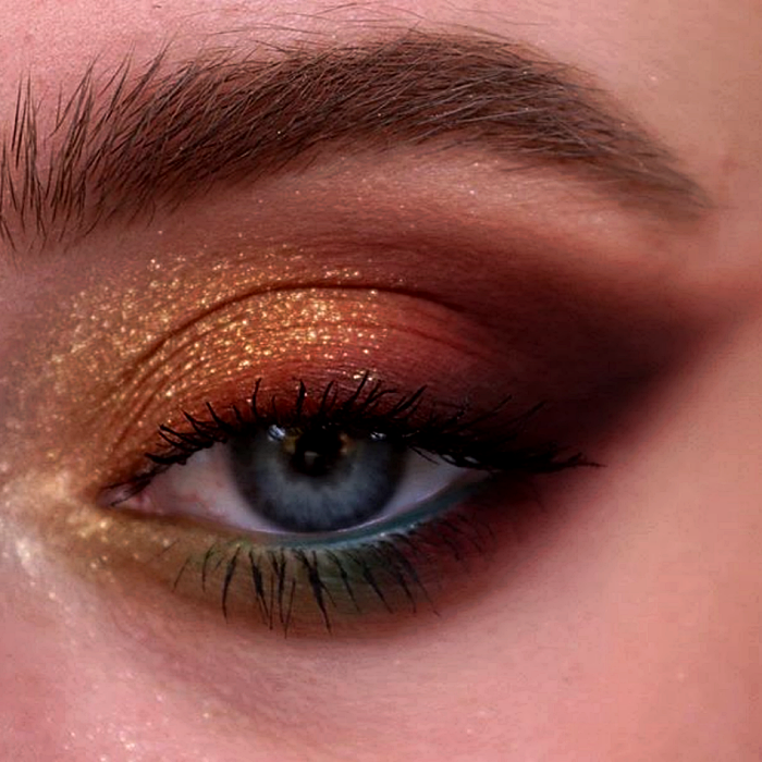 eye makeup with gold, brown, yellow, green, blue and cherry shadows, with gold glitter