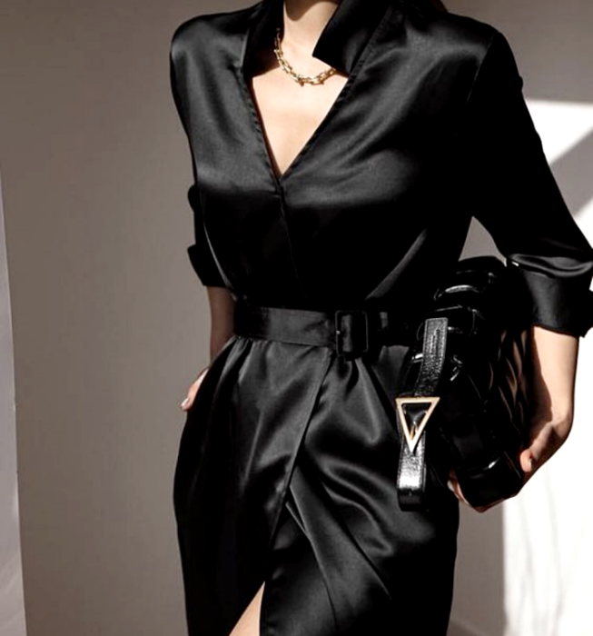 girl wearing black satin dress with shirt collar, 3/4 sleeves and waist adjustment