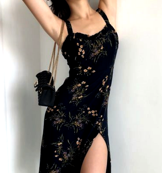girl in black strapless dress with yellow flower print and leg opening