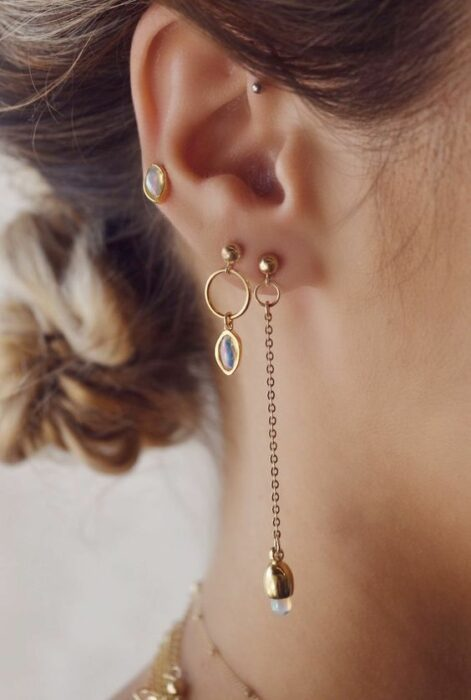 Girl with golden buckles and long rings; 13 Creative Ways to Wear More Than One Ear Piercing