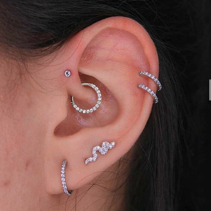 Girl with multiple rings in her ears; 13 Creative Ways to Wear More Than One Ear Piercing