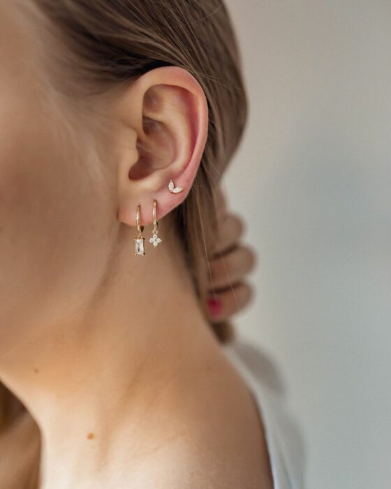 Girl with long earrings in her ear; 13 Creative Ways to Wear More Than One Ear Piercing
