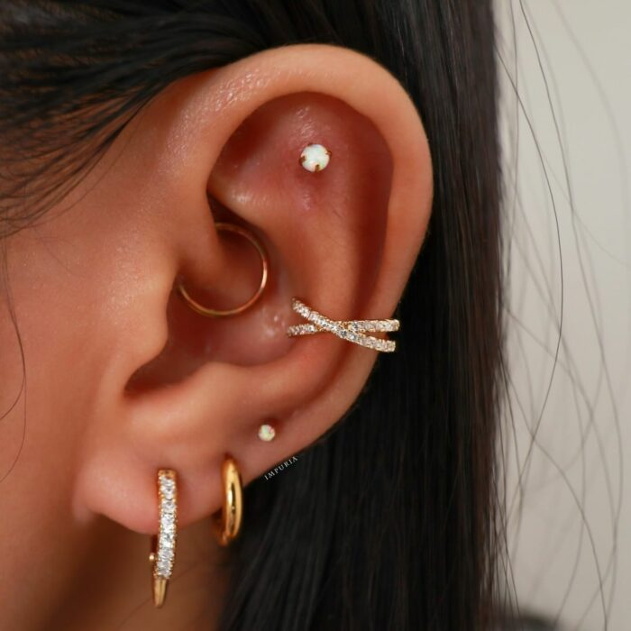 Girl with ring in the ear, long crystal earrings; 13 Creative Ways to Wear More Than One Ear Piercing