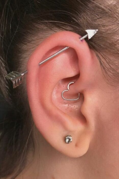Girl with multiple rings in her ear, in the shape of a heart; 13 Creative Ways to Wear More Than One Ear Piercing
