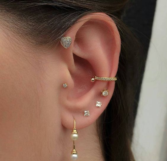 Girl with small buckles in her ear; 13 Creative Ways to Wear More Than One Ear Piercing