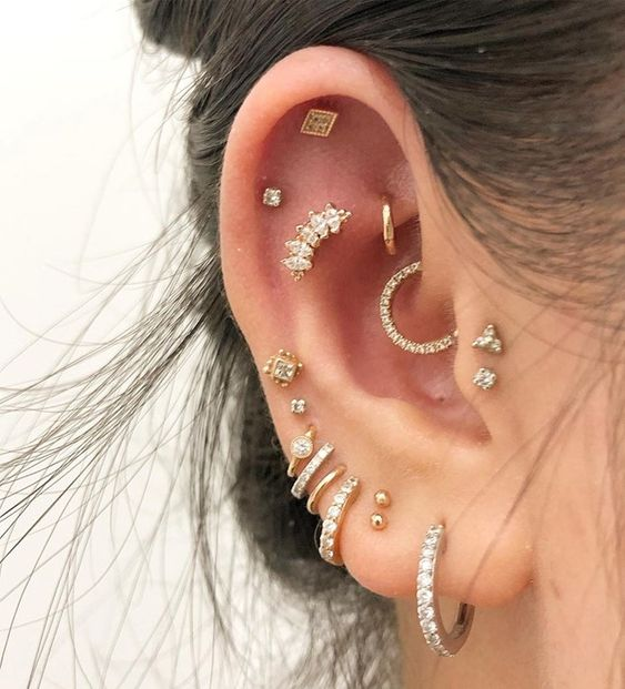Girl with multiple rings in her ear, all with precious stones; 13 Creative Ways to Wear More Than One Ear Piercing