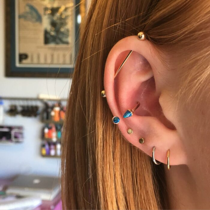 Girl with long and short rings and girls in the ear; 13 Creative Ways to Wear More Than One Ear Piercing