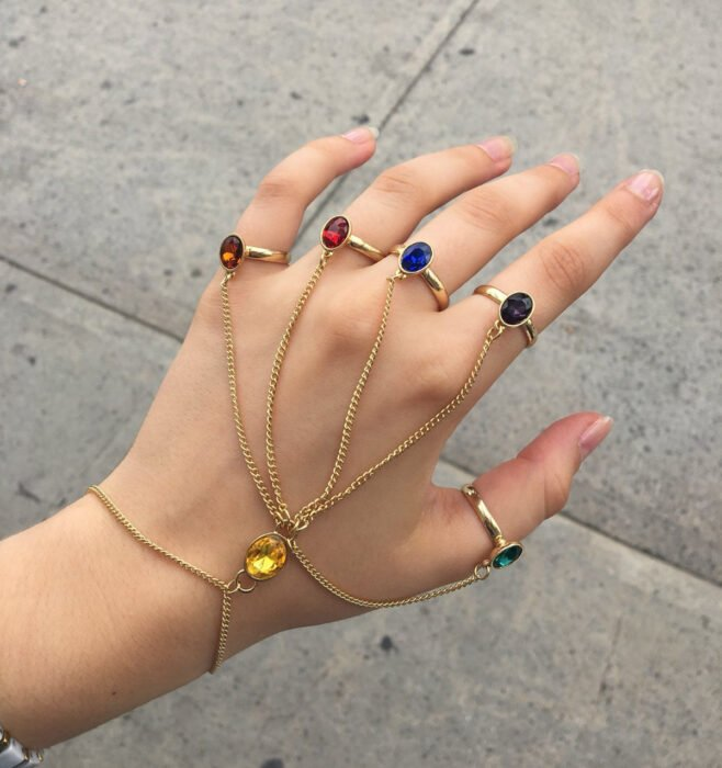 Hand bracelet, in the shape of an infinity gauntlet, golden chains with stones in amber, red, blue, purple, green and yellow colors
