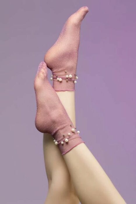 Pretty socks with semi-transparent pale pink and pearls decorating the ankle area