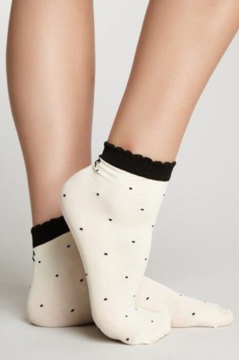 Pretty off-white socks with black polka dots