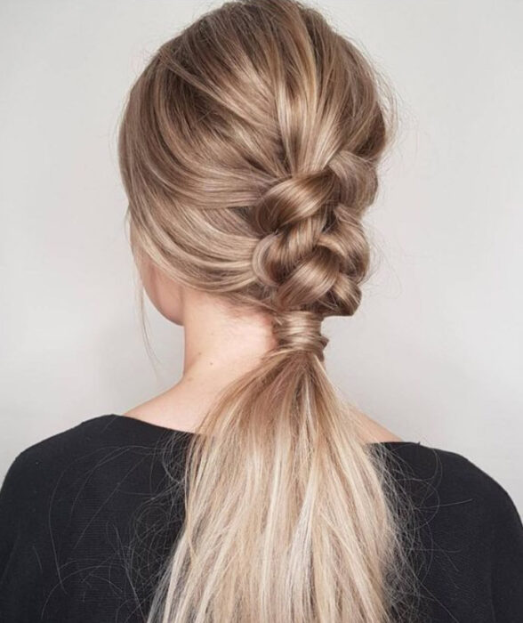 Blonde hair girl with braid all over her hair