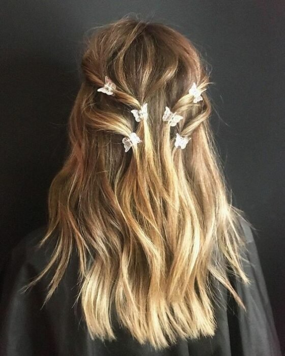 Blonde hair girl with decorated in hair with butterfly pins