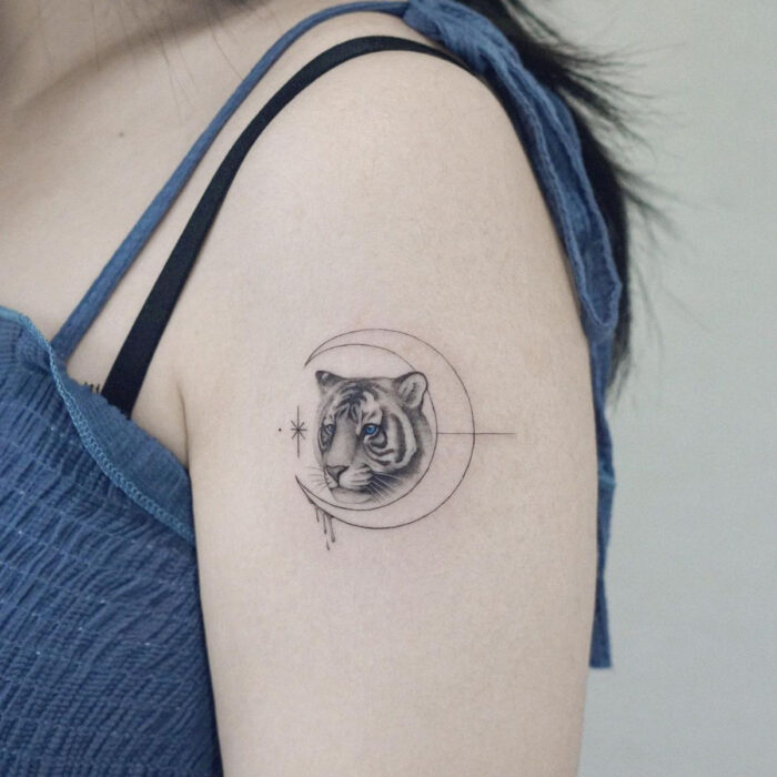 Pretty, small and feminine tattoos; Tiger with moon tattoo on shoulder