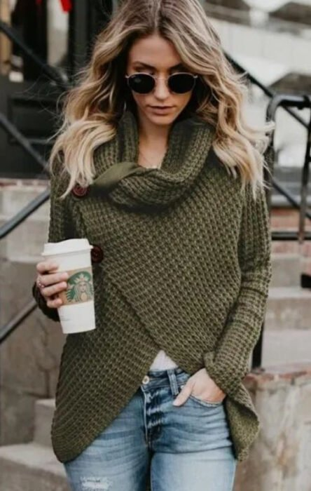 Girl wearing sunglasses, jeans and army green double-breasted turtleneck sweater
