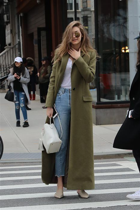 Girl wearing mom jeans, white shirt, white tote bag with long army green coat