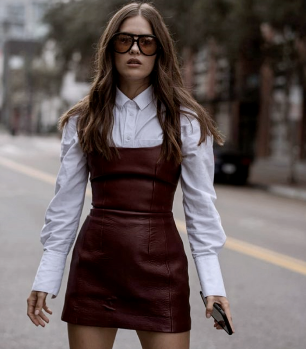 light-haired girl wearing sunglasses, tight-fitting leather cherry red dress, long-sleeved white shirt
