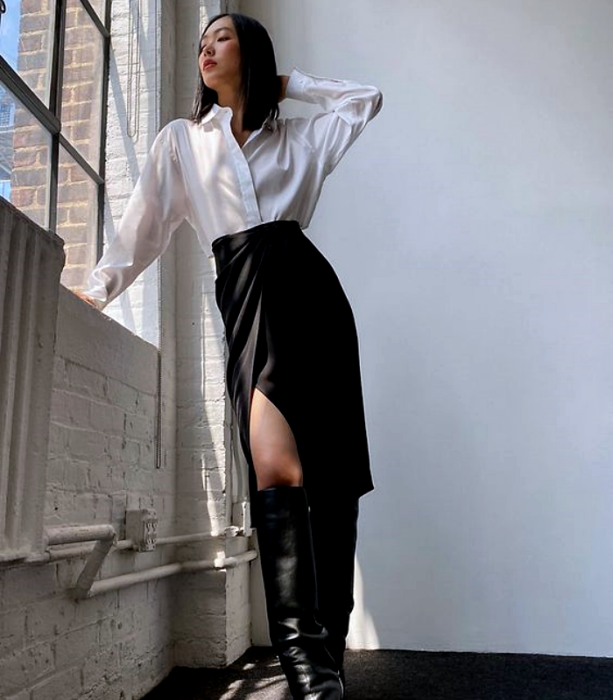 dark-haired girl wearing white long-sleeved shirt, long black leather skirt, long black leather boots