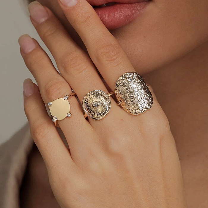 silver and gold rings, with large circles